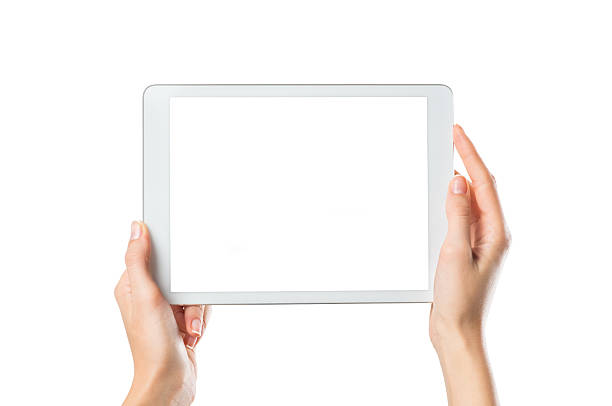 Hands holding digital tablet Closeup shot of woman hands holding digital tablet isolated on white background. Female hands holding a palmtop with white screen. Digital tablet with white display ready for your webpage or design. ipad stock pictures, royalty-free photos & images