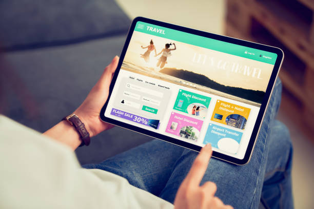 Hands holding digital tablet with application booking flight travel search ticket holiday and hotel on website discounted price, concept technology online marketing and promotion. stock photo