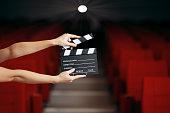 Film slate announcing premiere in movie theatre