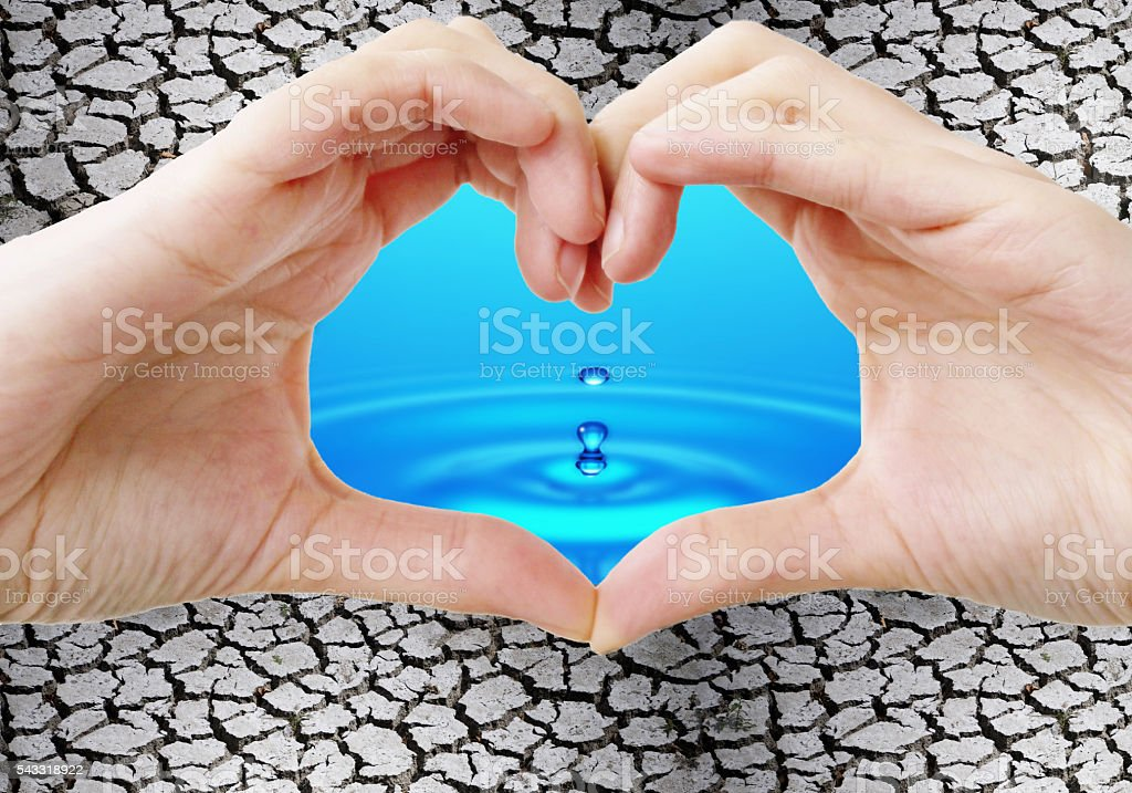 Hands holding drop water stock photo