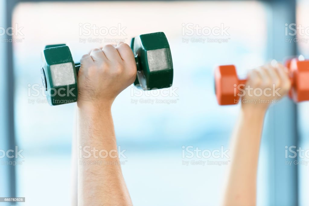 hands holding dumbbells at fitness studio royalty-free stock photo
