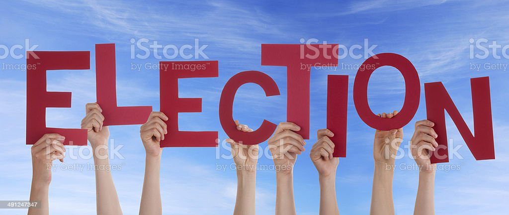 Hands Holding Election in the Sky stock photo