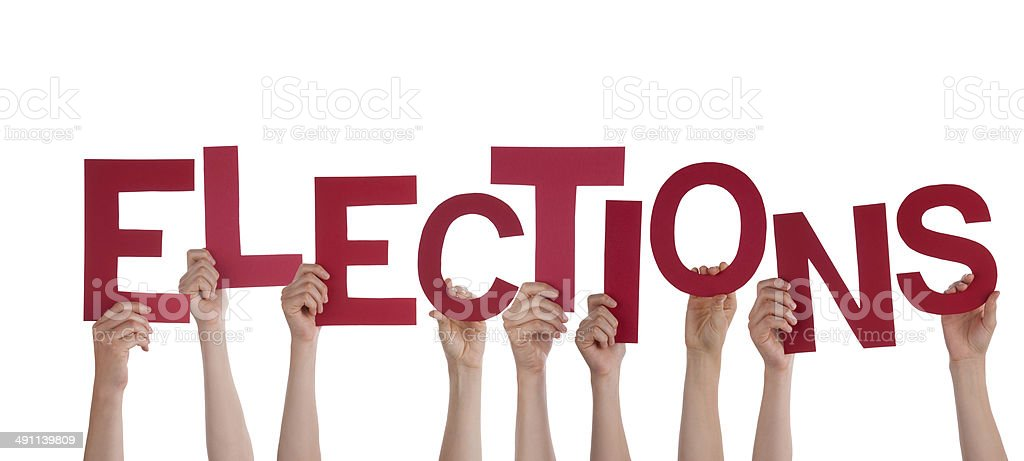 Hands Holding Elections stock photo