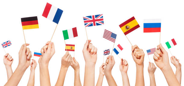 Hands holding flags of USA and EU member-states Hands holding small paper flags of USA and European Union member-states, isolated on white Anglo American stock pictures, royalty-free photos & images