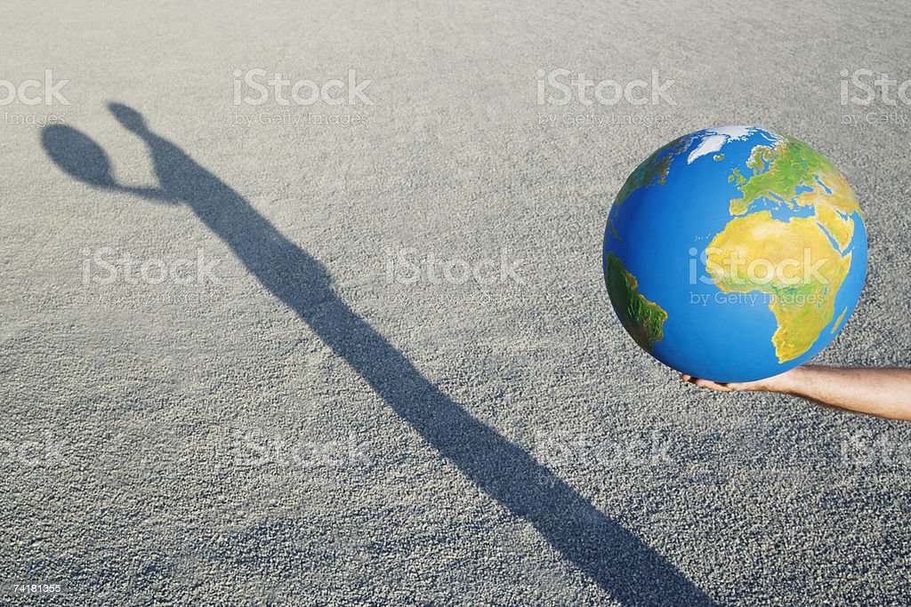 Hands holding globe outdoors stock photo