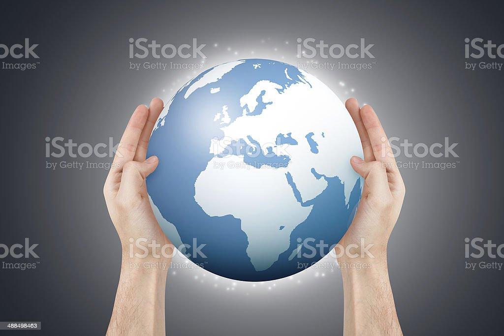 Hands Holding Globe stock photo