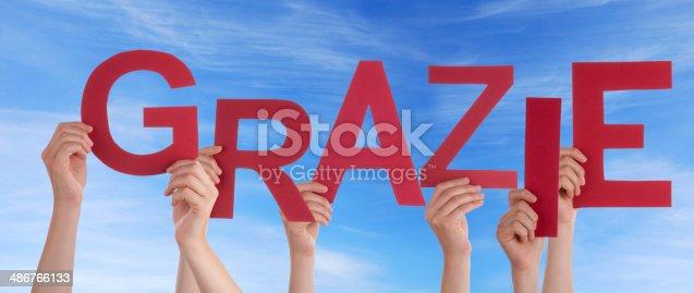 istock Hands Holding Grazie in the Sky 486766133