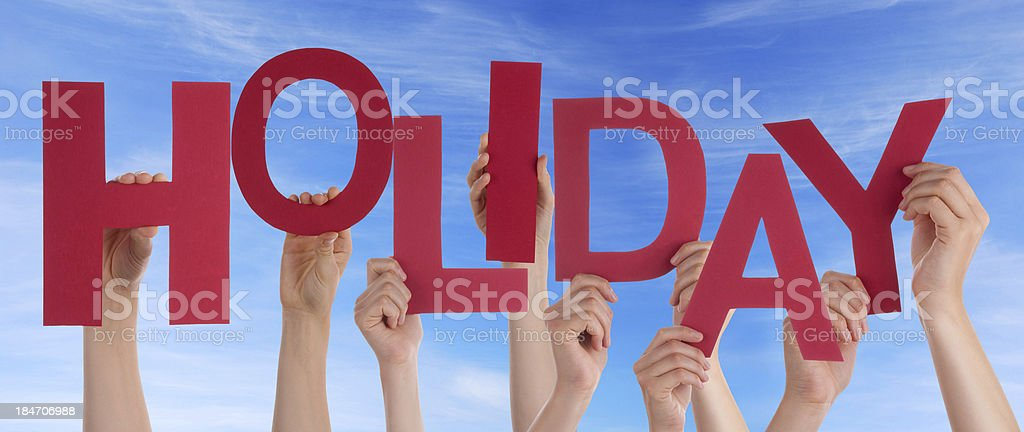 Hands Holding Holiday in the Sky stock photo