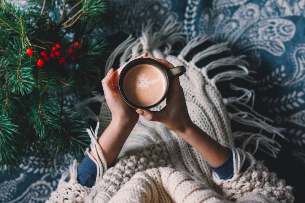 hands holding hot cup of coffee. hygge background. - hygge imagens e fotografias de stock