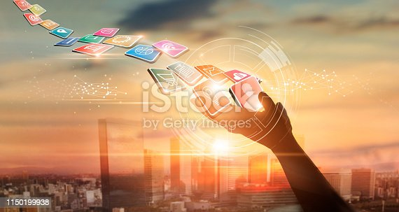 istock Hands holding icon payments, Digital marketing. Banking network. Online shopping and icon customer networking connection on city sunset background, Business technology concept. 1150199938