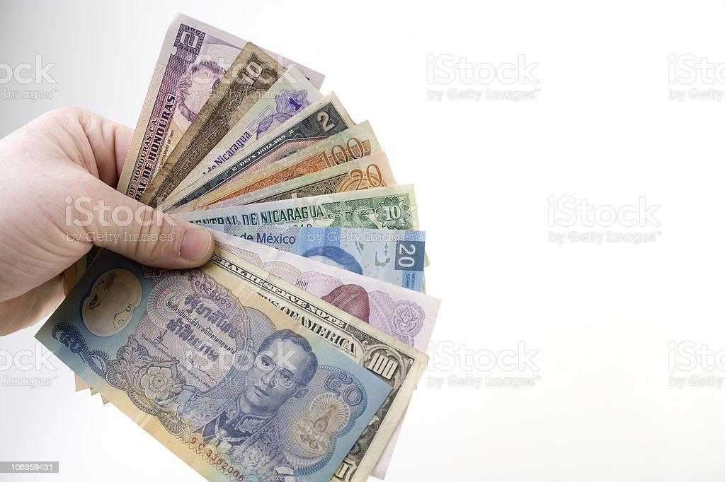 Hands Holding International Money royalty-free stock photo