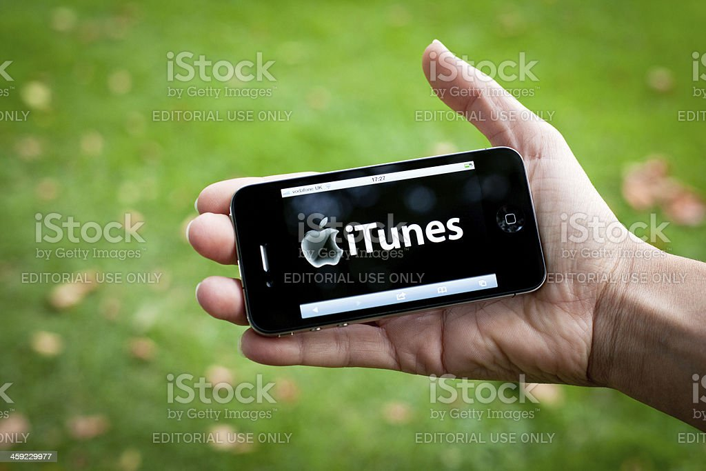 Hands Holding Iphone 4 with iTunes royalty-free stock photo