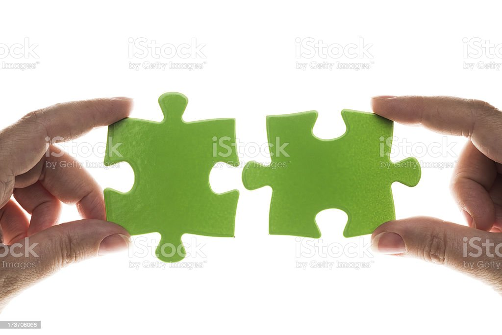 Hands holding jigsaw puzzle royalty-free stock photo