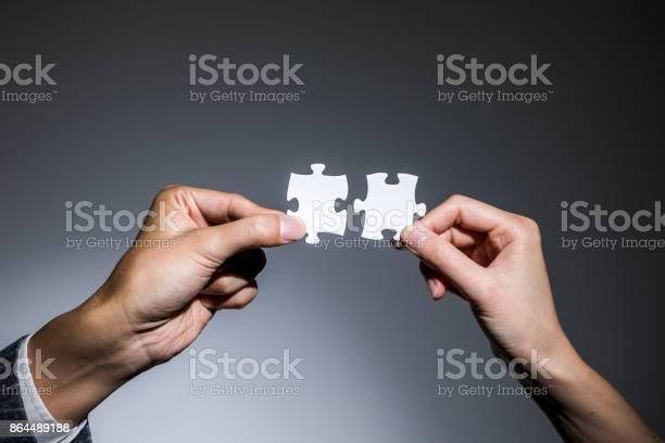 Hands holding jigsaw puzzles business to business business matching picture id864489188?b=1&k=6&m=864489188&s=612x612&h=wmrjc0hvksibaazdq9v0poqabyx4  rqonevlarjtww=