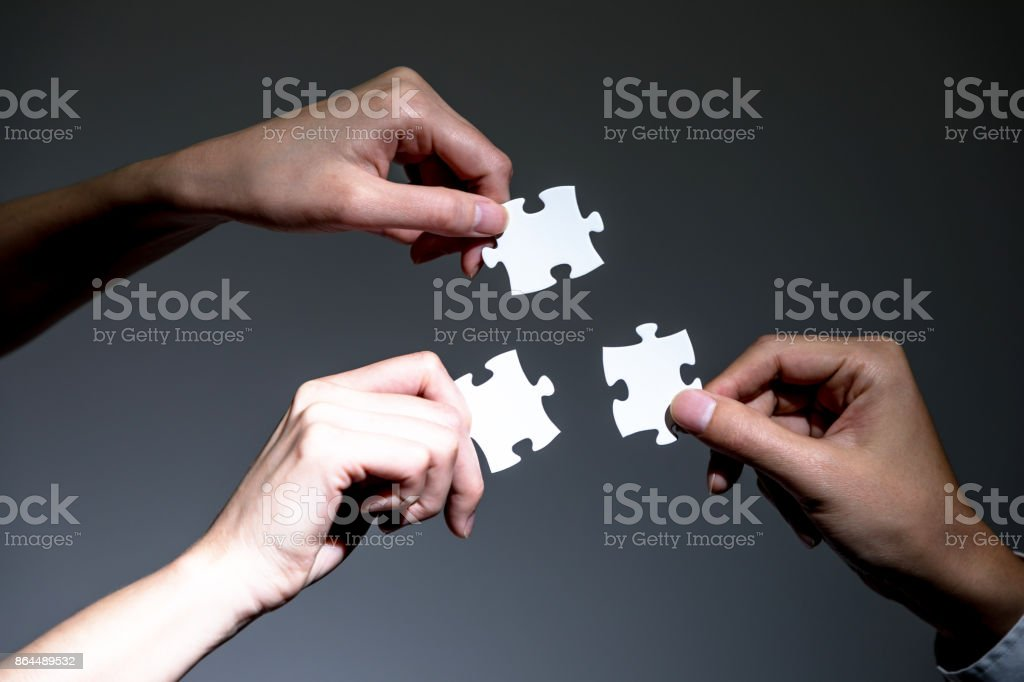 hands holding jigsaw puzzles, business to business, business matching concept stock photo