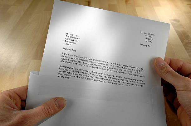 POV of Hands Holding Job Application Letter stock photo