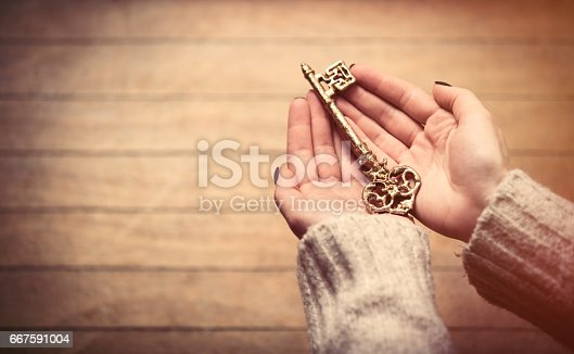 istock hands holding key 667591004