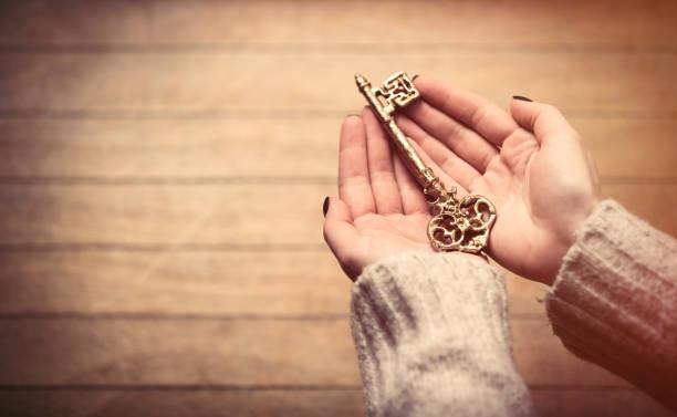hands holding key stock photo