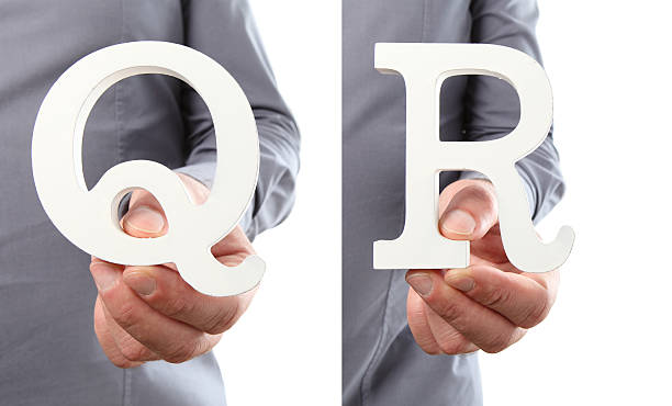 Hands holding letter Q and R from alphabet isolated stock photo