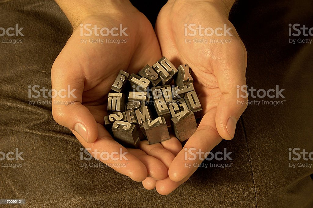 hands holding letters stock photo