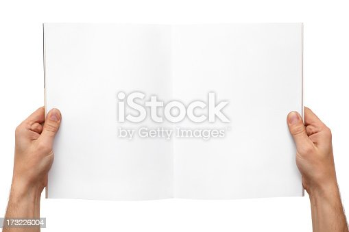 Hands holding a blank magazine for your copytext against white background.