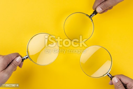 Concept of searching, detecting and analyzing on yellow background.