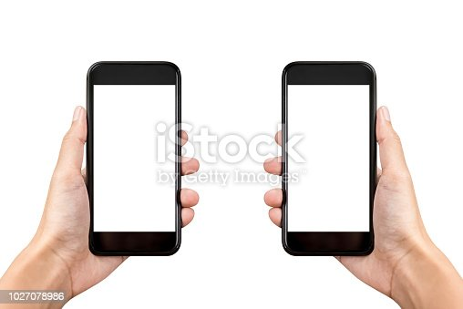 Two hands holding mobile phones on white background with empty screens for montage