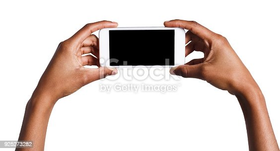 1132512759istockphoto Hands holding mobile smartphone with blank screen 925273282