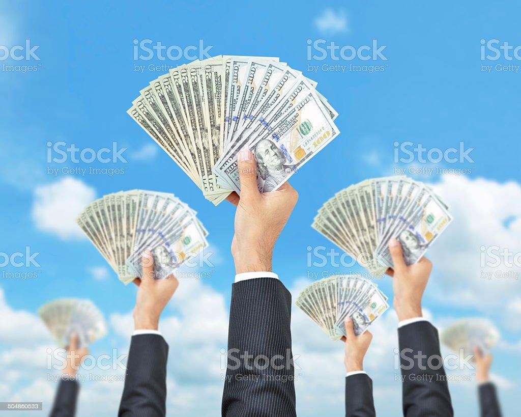Hands holding money - United States dollar (USD) bills stock photo