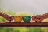 istock Hands holding mug with hot beverage, with tea 504281958