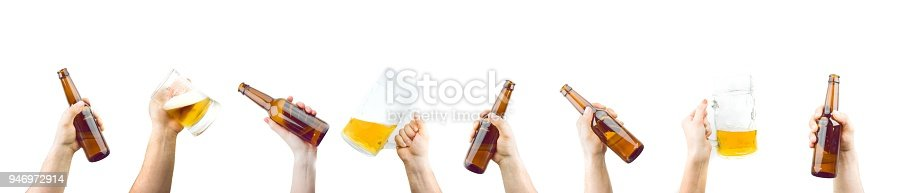 1144550840istockphoto Hands Holding Mugs And Bottles Of Beer 946972914