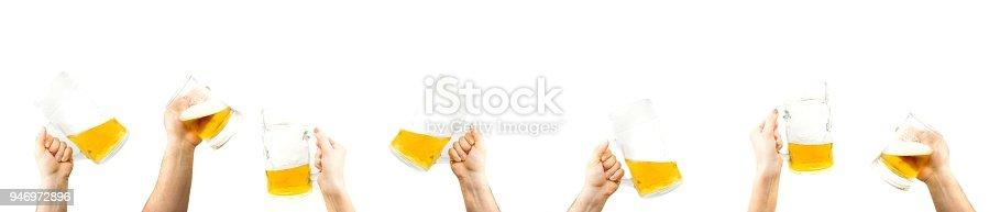 1144550840istockphoto Hands Holding Mugs Of Beer Up 946972896