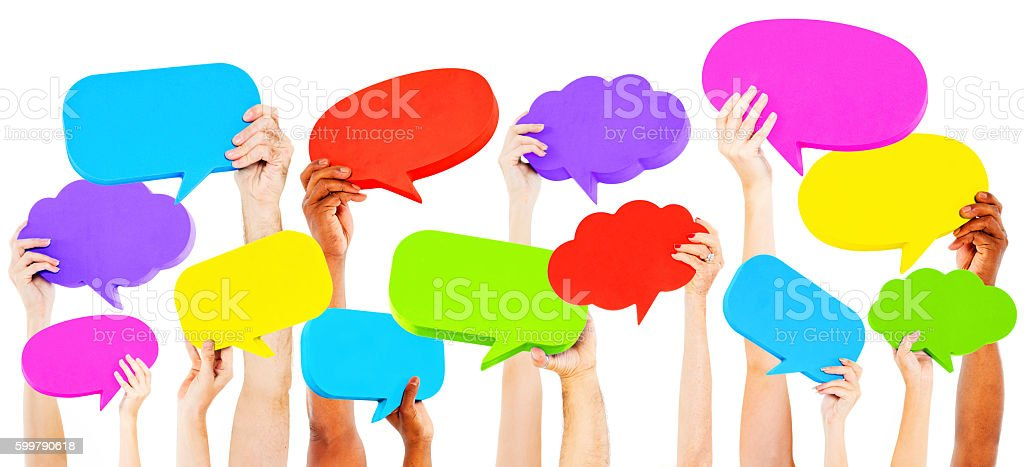 Hands Holding Multi Colored Speech Bubbles Concept stock photo