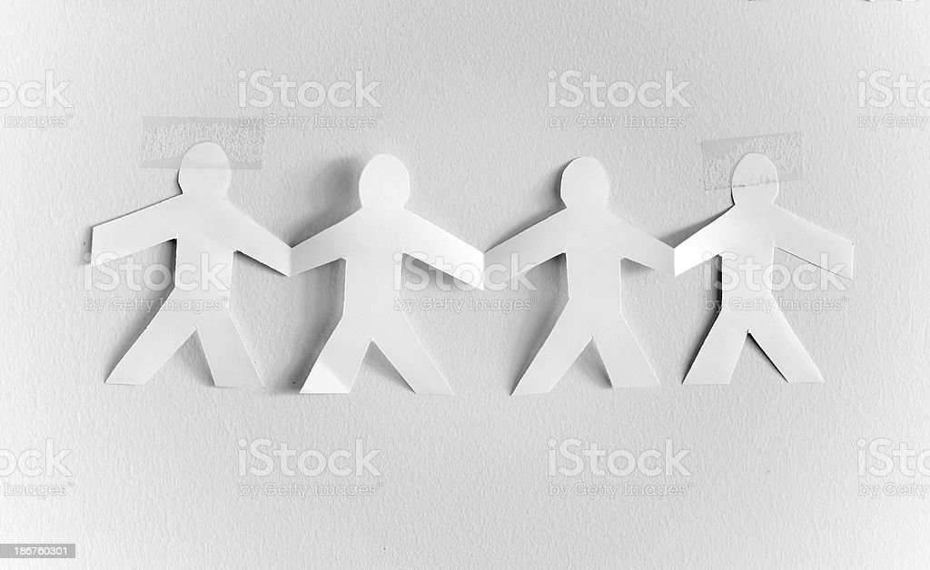 Hands holding paper cutout people royalty-free stock photo