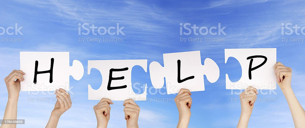 hands holding pieces of a puzzle with help royalty-free stock photo