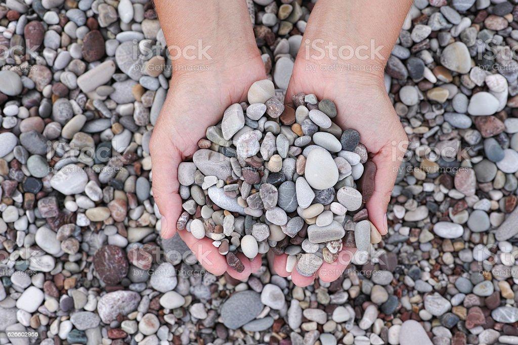 Hands holding pile of stones - Lizenzfrei Einzelwort Stock-Foto