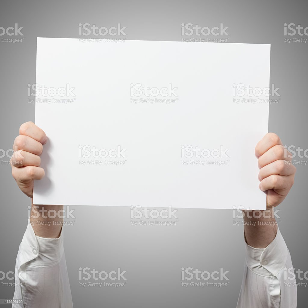 Hands holding placard billboard stock photo