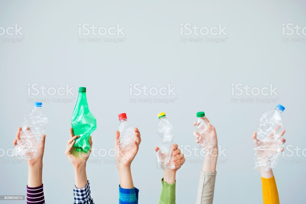 Hands holding plastic bottle stock photo