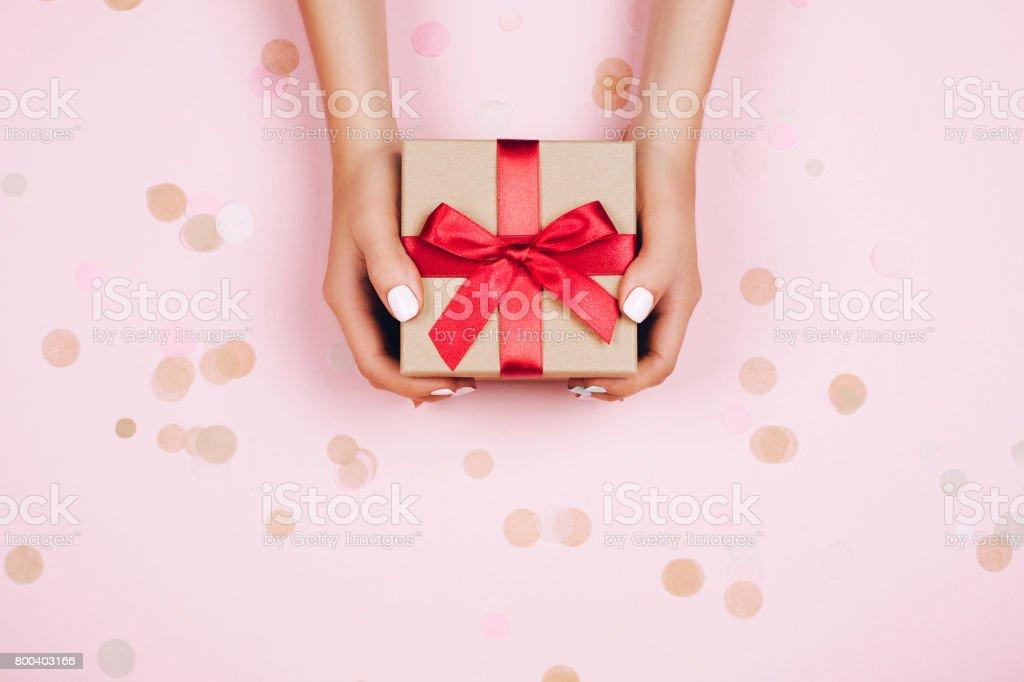 Hands holding present box stock photo