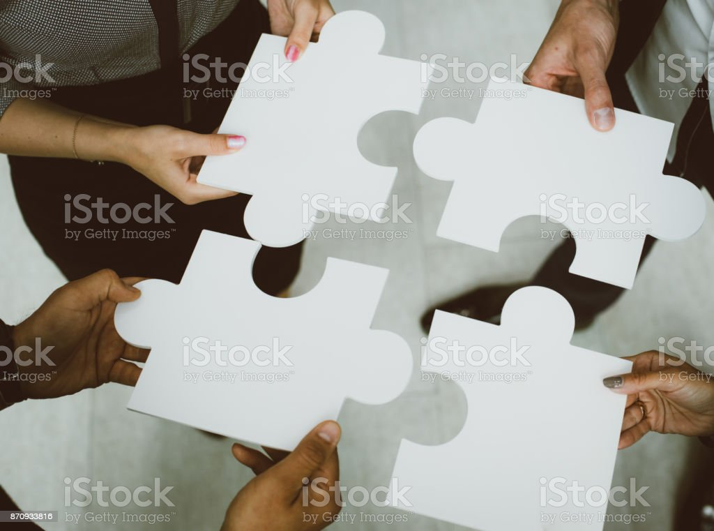 Hands holding puzzle stock photo