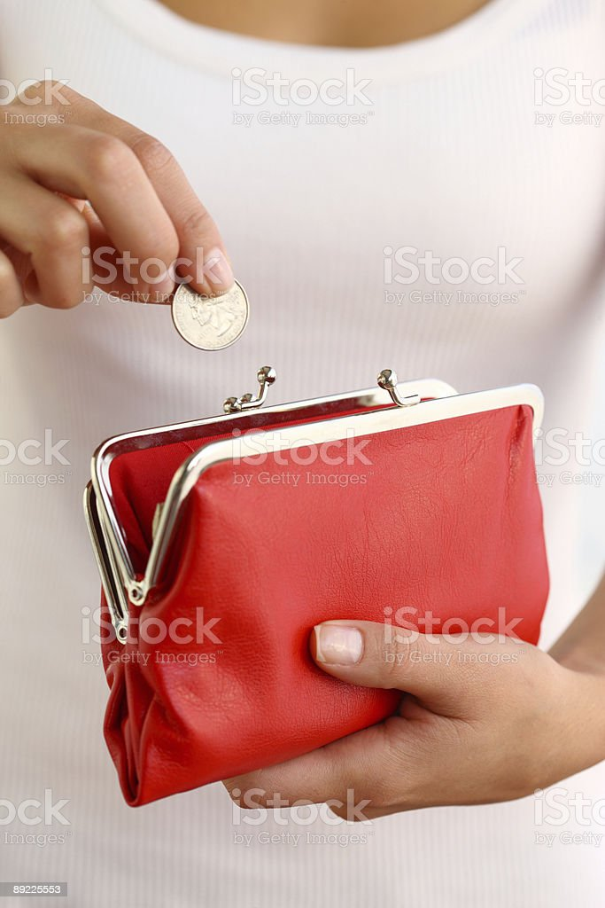 Hands holding red coin purse royalty-free stock photo