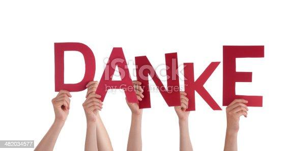 516544386 istock photo Hands Holding red Danke 482034577