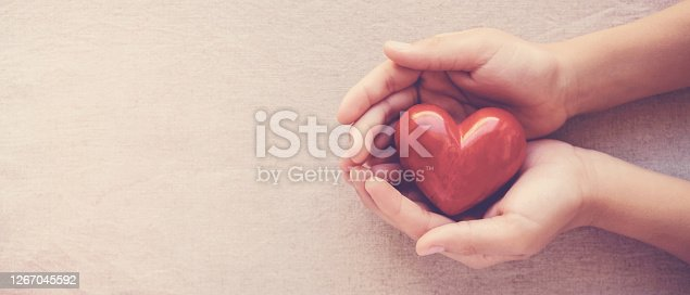 istock hands holding red heart, health care, love, organ donation, family insurance,CSR,world heart day, world health day, wellbeing, gratitude, be kind,be thankful concept 1267045592