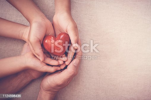 istock hands holding red heart, health insurance, donation concept 1124598435