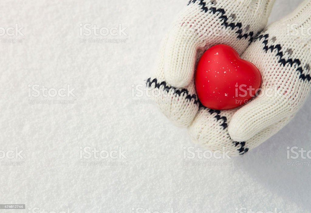 Hands holding red heart stock photo