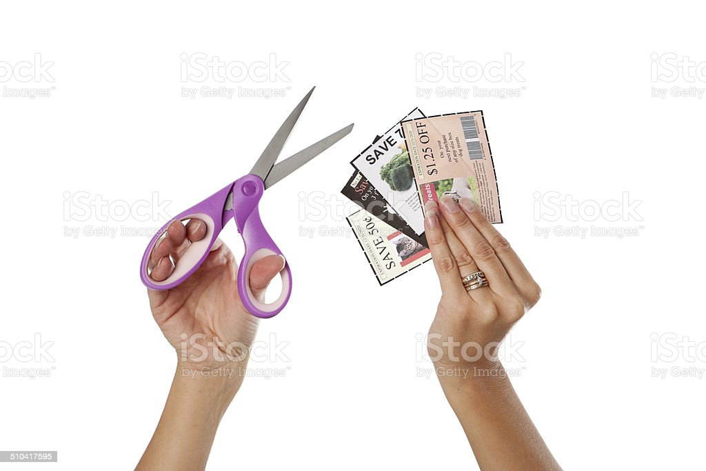 Hands Holding Scissors And Coupons stock photo