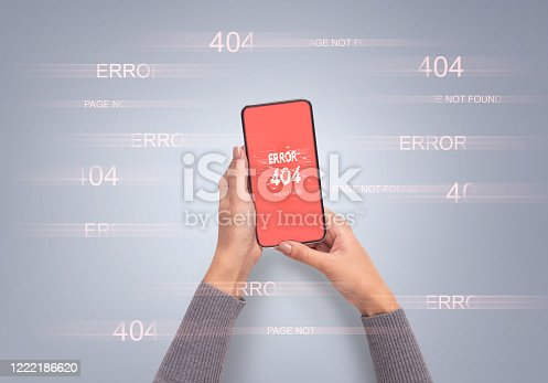 istock Hands holding smart phone with error 404 or not found icon 1222186620
