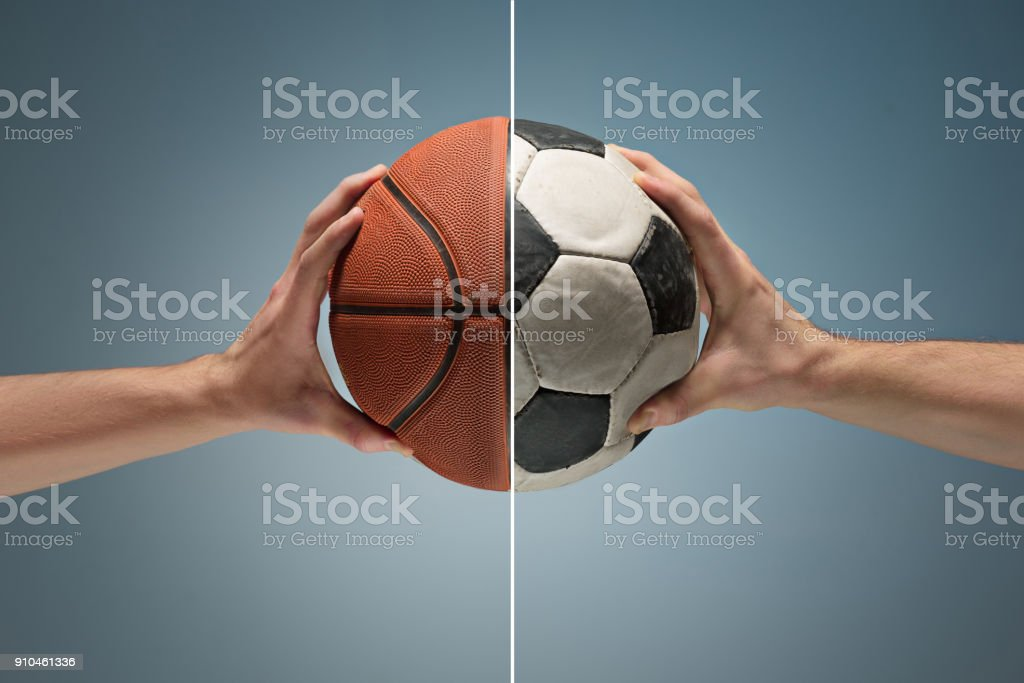 Hands holding soccer ball stock photo