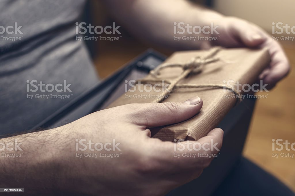 Hands Holding Suspicious Package. Bribe and Corruption Concept. stock photo