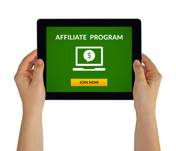 Hands holding tablet with affiliate program concept on screen Hands holding digital tablet computer with affiliate program concept on screen. Isolated on white. All screen content is designed by me affiliate stock pictures, royalty-free photos & images